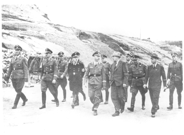 Reich Chief of the SS Heinrich Himmler (5th from left) during an inspection of the Kastenhof Quarry, accompanied by Ernst Kaltenbrunner (1st from left), at this time a Senior SS and Police Commander in Vienna; Karl Wolff (2nd from left), Head of the Personal Staff of the Reich Chief of the SS; August Eigruber (4th from left), Reich Governor of Oberdonau; Karl Mummenthey (6th from left), Head of Section W I (Stone and Earth) at the SS Economic and Administrative Office; Kurt Paul Wolfram (6th from left), Operations Manager of the DESt in Gusen, 1941 (photo credits: KZ-Gedenkstätte Mauthausen / Collections)