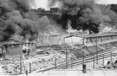 Due to catastrophic hygienic conditions and the imminent danger of spreading diseases, the barracks of camp Gusen II were burnt down by the US miltary administration on May 17th 1945. (photo credits: Courtesy of Maj. Charles R. Sandler, US 11th Armored Division, 21st Armored Infantry Battallion)