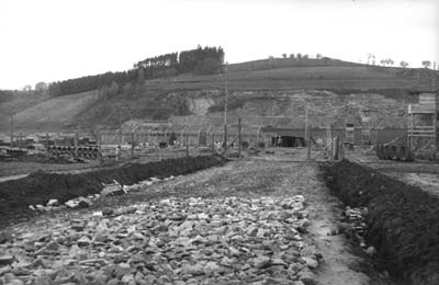 "Main entrance to the camp befor the construction of the ""Jourhaus"", spring 1940 (photo credits: SS-Foto, Courtesy of Museu d'Història de Catalunya, Barcelona: Fons Amical de Mauthausen)"